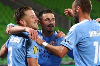Melbourne City captain Scott Jamieson (left) is feeling positive about the new A-League campaign.