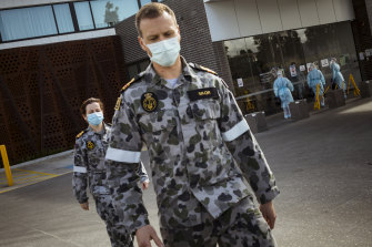 ADF troops help health workers at Epping Gardens Aged Care on Tuesday.