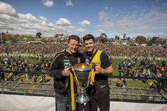 Coach Damien Hardwick and captain Trent Cotchin with the premiership cup at Punt Road on Sunday, where tens of thousands of Tiger faithful gathered to celebrate.