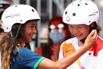 Rayssa Leal of Brazil, 13, greets Momiji Nishiya. also 13, during the women's street skateboard final in Tokyo.