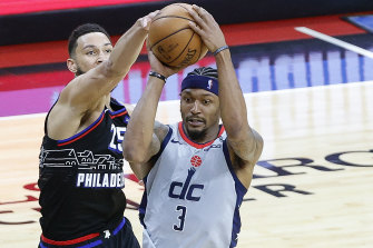 Simmons blocks Bradley Beal of the Wizards. The Australian is a contender for defensive player of the year.