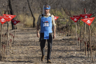 Britain's Prince Harry walks through a minefield in Dirico in Angola.