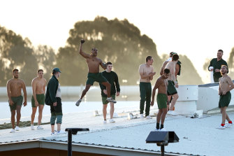 Prison inmates are seen on the roof of Parklea Correctional Centre on Monday afternoon.
