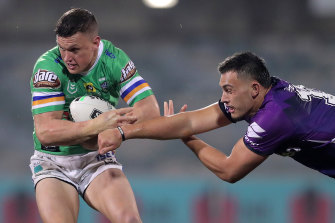 Jack Wighton is tackled by Tino Faasuamaleaui.