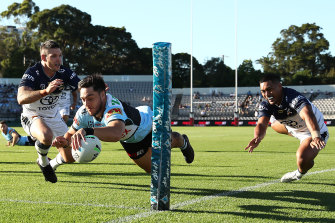 Mawene Hiroti of the Sharks scores a try during the round four match against North Queensland.
