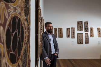 Curator Ben Thomas at Trinity College with the bark paintings.
