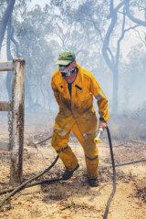 A firefighter battles the blaze at Deepwater.