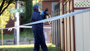 Forensic police officers are  inspecting the property in Bedford.