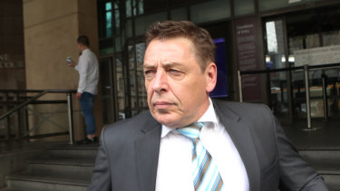 "Mark ""Bomber"" Thompson leaves a hearing at Melbourne Magistrates Court last year."