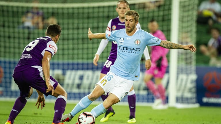 Full stretch: City's Luke Brattan swerves to avoid Perth's Christopher Ikonomidis