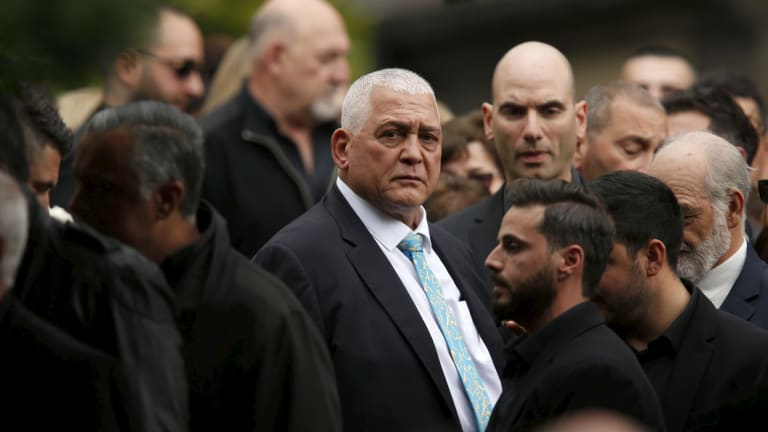 Mick Gatto is surrounded by friends and family at his son Justin's funeral.