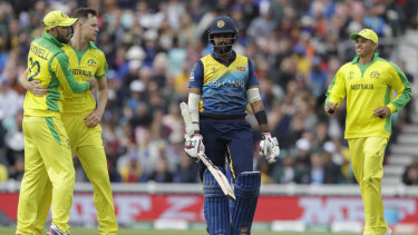 Australia's Jason Behrendorff (second left) after taking the wicket of Sri Lanka's Lahiru Thirimanne.