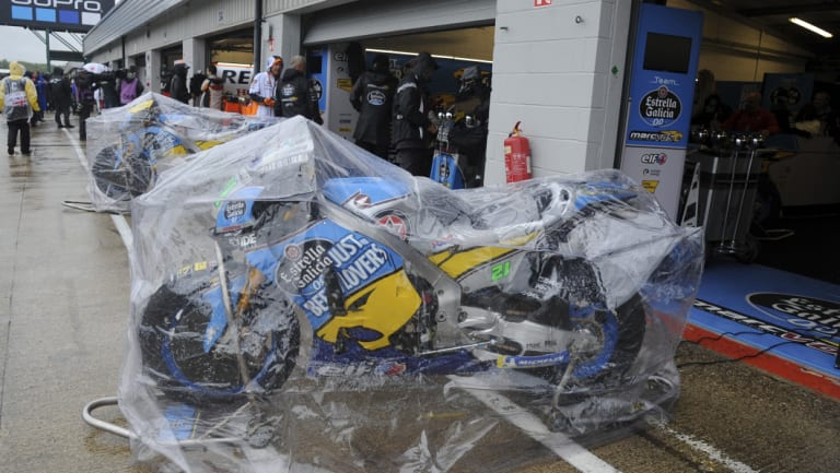 Going nowhere: MotoGP bikes protected from the weather in the cancelled British Grand Prix.