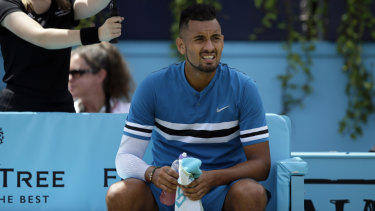 Nick Kyrgios with a water bottle during a change of ends.