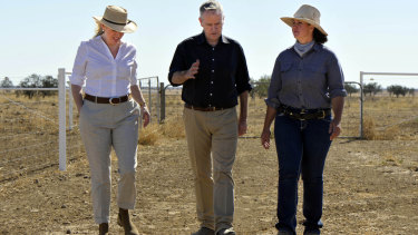 Mr Shorten (centre) and wife Chloe (left) discuss rural issues with grazier Jody Brown in Longreach last month.