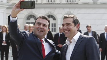 North Macedonia Prime Minister Zoran Zaev, left, takes a selfie with his Greek counterpart Alexis Tsipras.