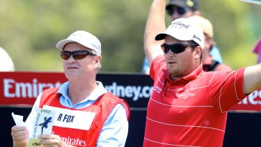Fox alongside his father Grant at the 2012 Australian Open.
