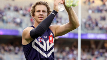 Nat Fyfe salutes the crowd at Optus Stadium after the Dockers unveiled a new game style against the Roos.