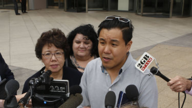 Curtis Cheng's son Alpha Cheng and widow Selina Cheng speak outside the court.