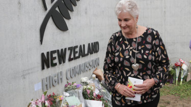 New Zealand High Commissioner Dame Annette King views tributes left at the front gate of the NZ High Commission in Canberra.