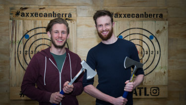 Axxe Canberra owner Chris Krajacic with manager Andrew Grimmett say hurling hatchets is not just for lumberjacks.