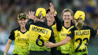 The Australian women's cricket team on their way to winning the T20 World Cup.
