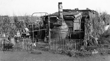 One of the tin shanties built on the Dudley Flats, the waste-grounds in West Melbourne, where many of the city's homeless lived. Everything used in the building has been salvaged from the rubbish tip.