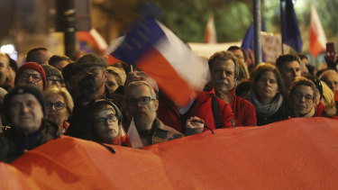 Demonstrators hold a rally to protest against changes to Poland's judiciary in Warsaw on Wednesday evening.