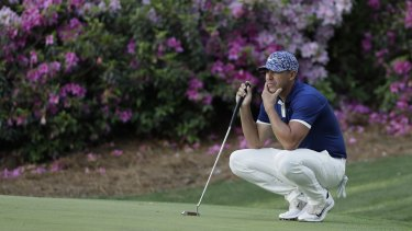 Brooks Koepka considers a putt at the 13th hole at Augusta.