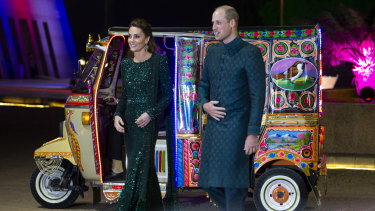 Prince William and Kate arrive in a traditionally-painted rickshaw.
