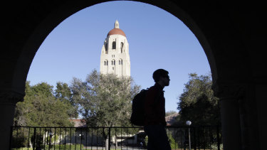 A student walks in front of Hoover Tower on the Stanford University campus in Palo Alto, California.