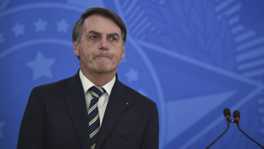 Brazilian governors and health authorities are at odds with President Jair Bolsonaro, above. Bolsonaro has called the pandemic a momentary, minor problem, saying strong measures to contain it are unnecessary.