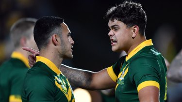 If the cap fits: Only one of Valentine Holmes and Latrell Mitchell can be a Cowboy next season.