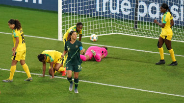 One of a kind: A pumped-up Sam Kerr celebrates the third of her four  goals against Jamaica.