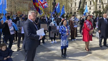 Rahima Mahmut from the World Uighur Congress with Conservative MPs Nus Ghani and Sir Iain Duncan Smith in London address a gathering before the genocide vote.