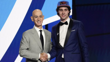 Josh Giddey on stage with NBA commissioner Adam Silver after hearing his name read out for the sixth overall pick in the 2021 draft.