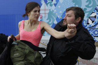 A Russian security officer attacks Tolokonnikova and a photographer as she and fellow members of Pussy Riot, stage a protest performance in Sochi, Russia, in 2014.