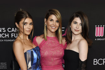 Lori Loughlin, centre, pictured in 2019 with her daughters Olivia Jade Giannulli, left, and Isabella Rose Giannulli.