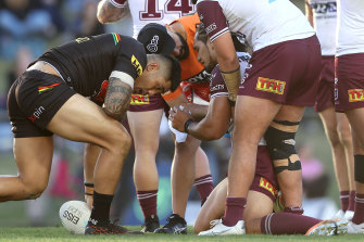 Sea Eagles forward Martin Taupau is attended to by a trainer on Saturday.