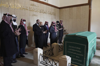 This photo from the Royal Court twitter account, shows Jordan's King Abdullah II, third right, Prince Hassan bin Talal, fifth right, Prince Hamzah bin Al Hussein, seventh right, and others pray during a visit to the tomb of the late King Abdullah I, in Amman Jordan, Sunday, April 11, 2021. King Abdullah II and his half brother Prince Hamzah have made their first joint public appearance since a palace feud last week. Members of the Jordanian royal family Sunday marked the centenary of the establishment of the Emirate of Transjordan, a British protectorate that preceded the kingdom.