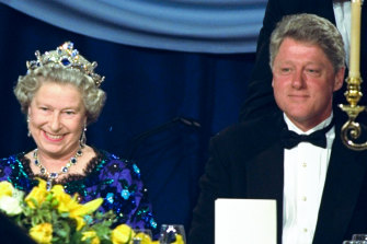 Queen Elizabeth sits alongside President Bill Clinton at a dinner in the Guildhall in Portsmouth, England, commemorating the 50th anniversary of D-Day.