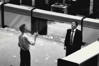 Two operators play two-up during a break on October 20, 1987.