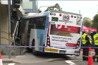 The bus and sedan collided at about 8am on Saturday near the intersection of Argyle and O'Connell streets in Parramatta.