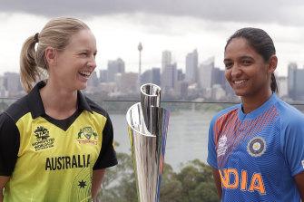 Australia's Meg Lanning and India's Harmanpreet Kaur with the Twenty20 World Cup.