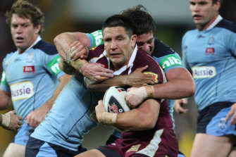 Trent Waterhouse tackles Steve Price before the fireworks erupt.