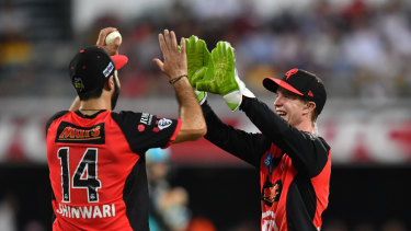 Usman Shinwari (left) and Sam Harper celebrate a wicket against the Heat.