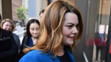 Greens Senator Sarah Hanson-Young arrives at court with her legal team.