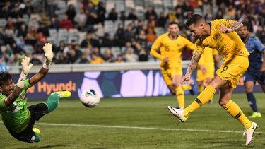 Jamie Maclaren of Australia scores his third goal against Nepal.