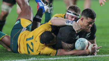 Vain effort: Samu Kerevi and Izack Rodda try to stop Sonny Bill Williams scoring.