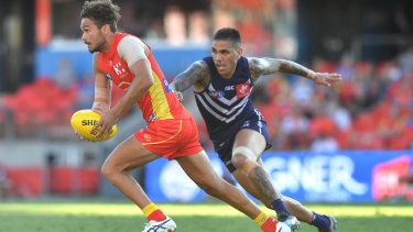 Walters puts the pressure on Gold Coast's Jarrod Harbrow to try retain the ball inside Fremantle's forward half last week.